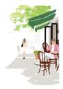街のオープンカフェでお茶を飲み本を読む男性