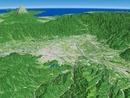 長野県南部上空から駿河湾へ向けて河川と甲府盆地を望む