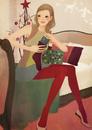ベッドに座りクリスマスプレゼントを用意する女性