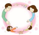 ピンクの丸を囲む家族