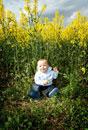 Baby sitting in field