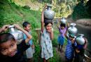 Bru tribe children collecting water