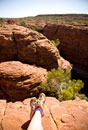 Hiker resting on edge of Kings Canyon