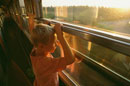 Boy looking out of window of a French train