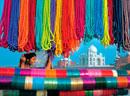 View through bead stall towards woman and Taj Mahal