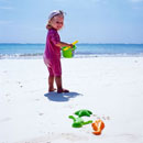 Child playing on beach with bucket and spade