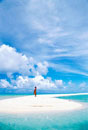 Woman standing on a sand bar