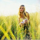 Girl Crouching in Field