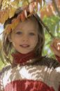 Girl standing under an autumn tree