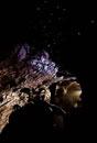 Man Observing Glowworms at the Waitomo Caves
