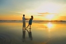 Couple Dancing on the Beach at Sunrise