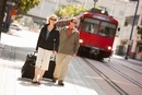 Couple with Luggage at Train Station, San Diego, California