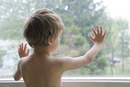 Boy with Chicken Pox Looking Out Window
