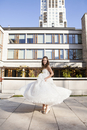 Portrait of Bride twirling in dress outdoors in City Park, Toronto, Ontario, Canada