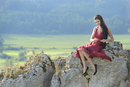 Portrait of Young Woman Sitting on Rocks, Upper Palatinate, Bavaria, Germany