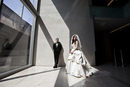 Portrait of Bride and Groom in lobby of building, Toronto, Ontario, Canada
