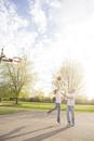 Couple playing basketball in neighbourhood park, Toronto, Ontario, Canada
