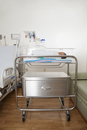 Newborn baby in hospital room, in neonatal bassinet, Maryland, USA