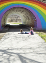 Two Sisters Drawing with Sidewalk Chalk by Rainbow Tunnel in Spring, East Don Trail, Toronto, Ontario, Canada