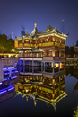 Yu Garden and Bazar with Huxinting Teahouse illuminated at Night, Shanghai Tower in the background, Old City of Shanghai, China