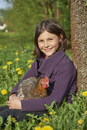 Portrait of Close-up of a Happy Girl with Chicken (Gallus gallus domesticus) in Meadow in Spring, Upper Patatinate,