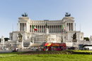 Monument to Vittorio Emanuele II at Piazza Venezia and red tour bus, Rome, Italy