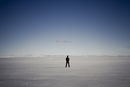 Man Standing In the Middle of Salt Flat