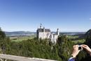 Germany, Bavaria, Swabia, Schwaben, Allgaeu, Ostallgau, Schwangau, Person taking picture of neuschwanstein castle from marienbr?