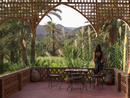 North Africa, Morocco, Mature woman in kasbah looking at view