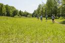 Germany, Bavaria, four children runnig on a meadow