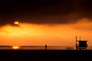USA, California, Santa Monica State Beach, Rear view of nude man standing on beach at sunset