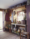 CHRISTMAS - Country. The Buttery. Small moss Christmas tree, entryway, rag rug, rustic furnishings, crocks, baskets, coat rack h