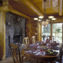DINING ROOM - Log home,  log walls, exposed beams, wood ceiling, stone fireplace, modern chandelier, provincial Queen Anne chair