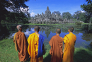 Buddhist monks standing in front of the Bayon temple, Angkor, UNESCO World Heritage Site, Siem Reap, Cambodia, Indochina, Asia