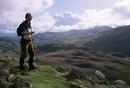Hill walker in the Snowdonia National Park, Gwynedd, Wales, United Kingdom, Europe