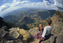 Tourist viewing breathtaking views at 14000 ft, Simien Mountains, Ethiopia, Africa