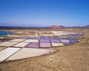 Salt pans and volcanoes in the background, near Yaiza, Lanzarote, Canary Islands, Spain, Atlantic, Europe