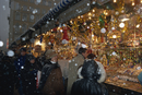 People shopping as snow falls at a Christmas market stall, Marienplatz, Munich, Bavaria, Germany, Europe