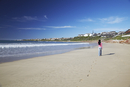 Woman walking on beach at St. Francis Bay, Western Cape, South Africa, Africa