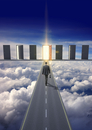 Businessman on road in clouds walking towards glowing doorwa