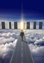 Businessman on road in clouds walking towards glowing doorwa
