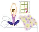 寝起き。ベッドの上で伸びをする女の子