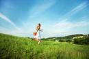 woman skipping in field