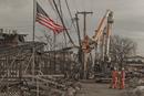 working to rebuild neighborhood after hurricane sandy destruction