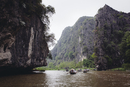 Boats drift through the rivers of Ninh Binh, Vietnam