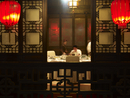 Chinese businessman and waitress in restaurant