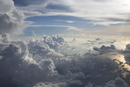 Aerial view of cloud formations over ocean