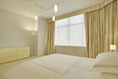 Simple Empty White Bedroom With Gold Drapes