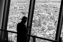 Silhouettes of people watching Tokyo from the Skytree