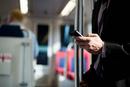 Businessman on train using smartphone